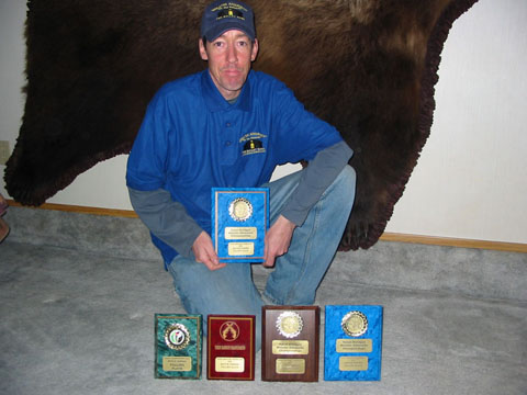 John Simmons at home with his plaques
